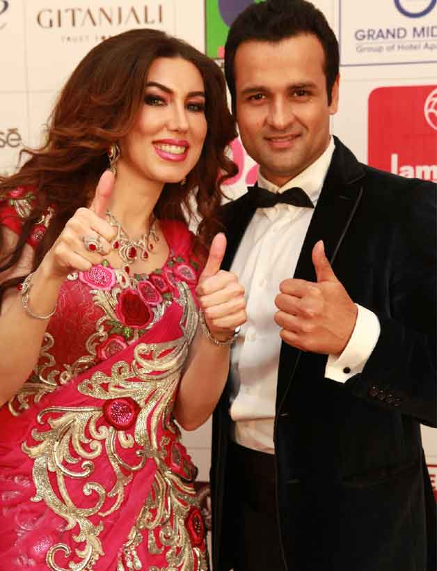 Anchors Rohit Roy with Rahaf Altawi