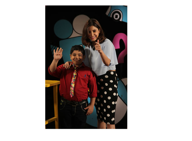 Anushka Sharma poses with host Sadhil kapoor